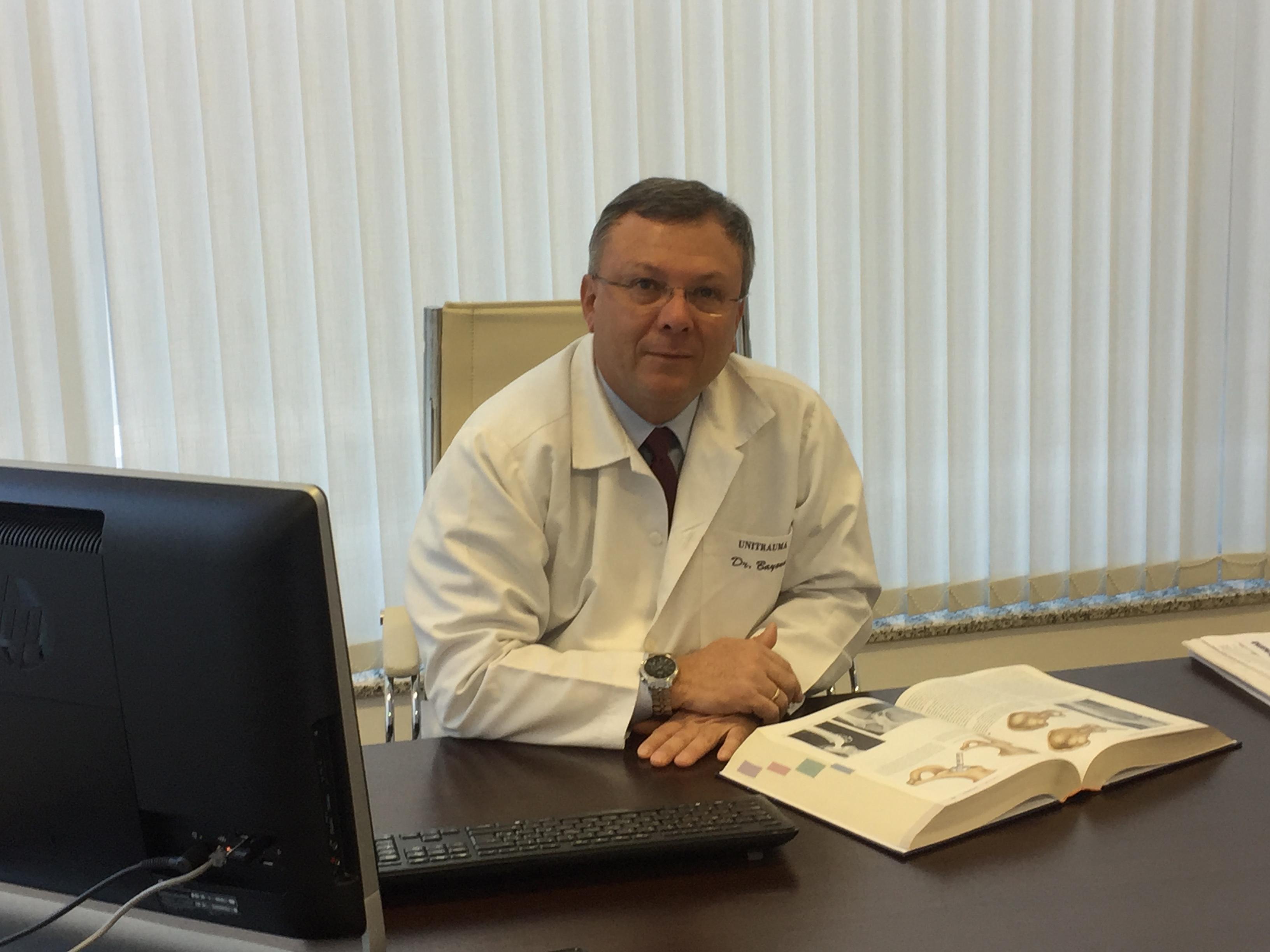 Dr. DAVID BAYONA